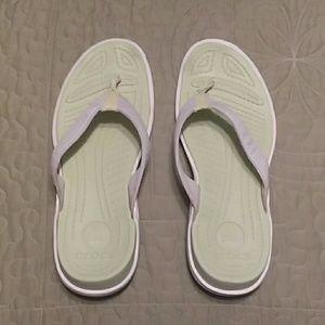 Used croc flip flops